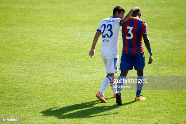 Coke of Schalke and Patrick Van Aarnholt of Crystal Palace chat at the end of the Pre Season Friendly between Crystal Palace and FC Schalke 04 at...