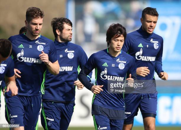 Coke of Schalke Atsuto UCHIDA of Schalke Franco DI SANTO of Schalke looks on during a training session at the Schalke 04 Training center on March 28...