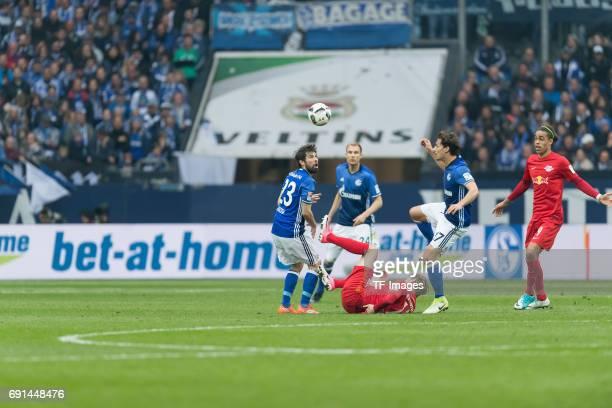 Coke of Schalke Emil Forsberg of Leipzig and Benjamin Stambouli of Schalke battle for the ball during the Bundesliga match between FC Schalke 04 and...