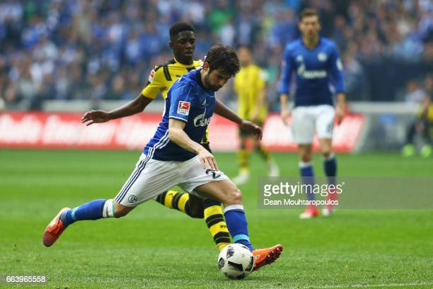 Coke of Schalke gets past the tackle from Ousmane Dembele of Borussia Dortmund during the Bundesliga match between FC Schalke 04 and Borussia...