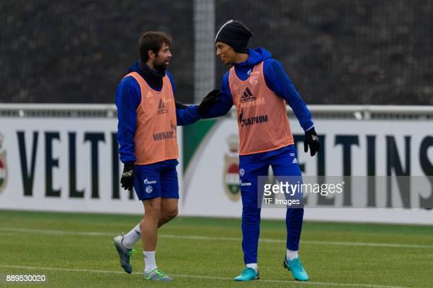 Coke of Schalke speaks with Thilo Kehrer of Schalke during a training session at the FC Schalke 04 Training center on December 05 2017 in...