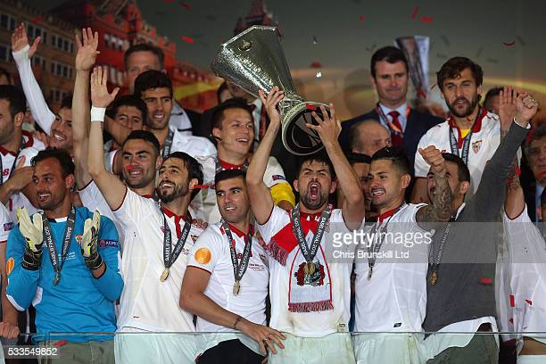Coke of Sevilla lifts the trophy following the UEFA Europa League Final match between Liverpool and Sevilla at St JakobPark on May 18 2016 in Basel...