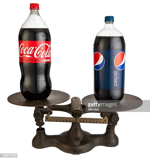 coke vs pepsi on antique jacobs scale - dual stock photos and pictures