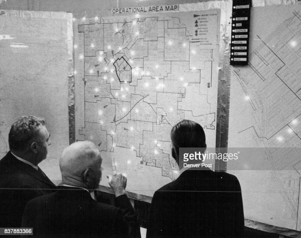 Col Allen center confers with John Powell left and Robert Weber Denver city aides as they review the status of the city master map showing all...