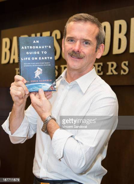 Col Chris Hadfield signs copies of his new book An Astronaut's Guide To Life On Earth at Barnes Noble bookstore at The Grove on November 11 2013 in...