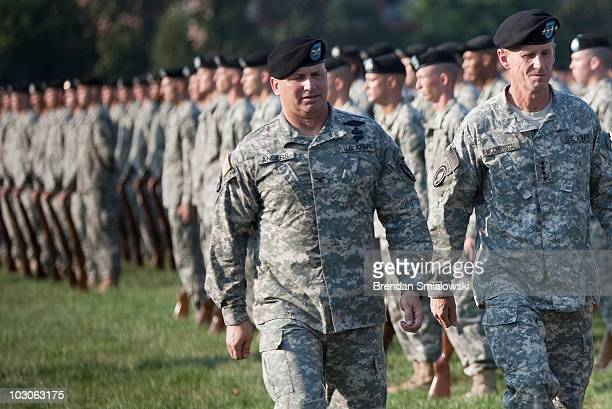 Col David Anders commander of the 3rd US Infantry Regiment inspects troops with Gen Stanley McChrystal during a retirement ceremony at Fort McNair...