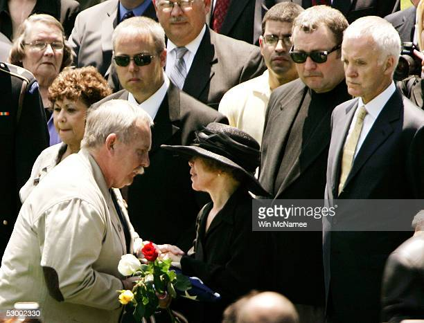 Col David Hackworth's widow Eilhys England Hackworth receives the flag that draped her husband's casket from retired SP/4 Jerry Sullivan following...