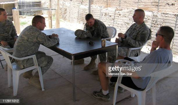 Col David Paschal hears from soldiers at Gaines Mills a small US base on the site of an old summer home of the notorious 'Chemical Ali' one of Saddam...