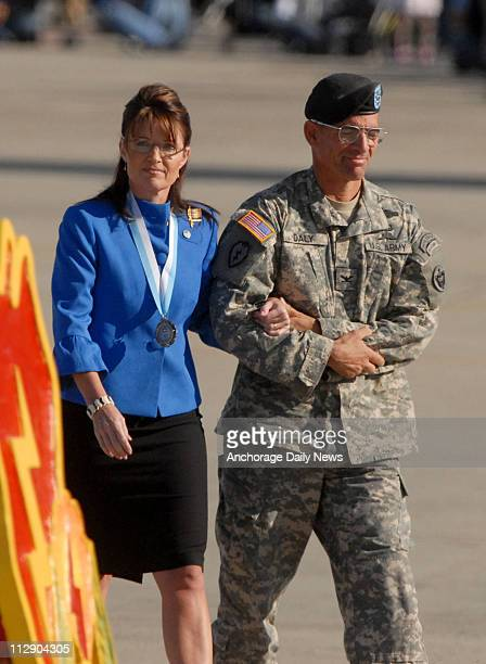 Col Ed Daly Department Officer for US Army Alaska escorts Republican vice presidential candidate Gov Sarah Palin after she spoke at a Stryker Brigade...