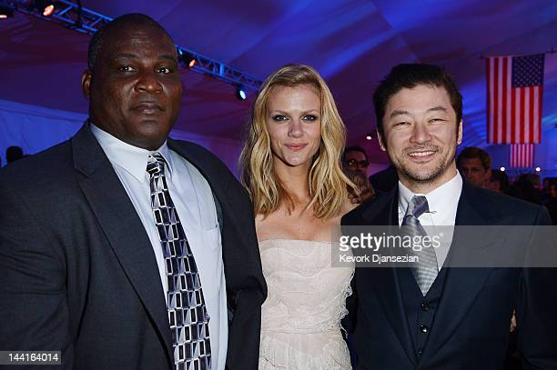 Col Gregory D Gadson and actors Brooklyn Decker and Tadanobu Asano attend the after party for the Los Angeles premiere of Battleship at Nokia Theatre...