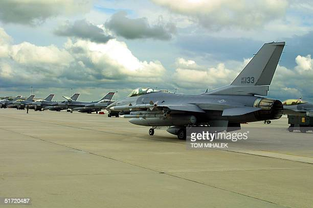 Col. Michael Cosby, Wing Commander of the 177th Fighter Wing, New Jersey Air National Guard, taxis his F-16C Fighting Falcon past a row of other...