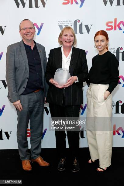 Col Needham Jo Burn winner of IMDB Project Management Award presented by Stacey Dooley in the winners the Women in Film and TV Awards 2019 at Hilton...