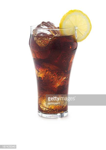 Cola drink with ice in a glass with a lemon slice on it