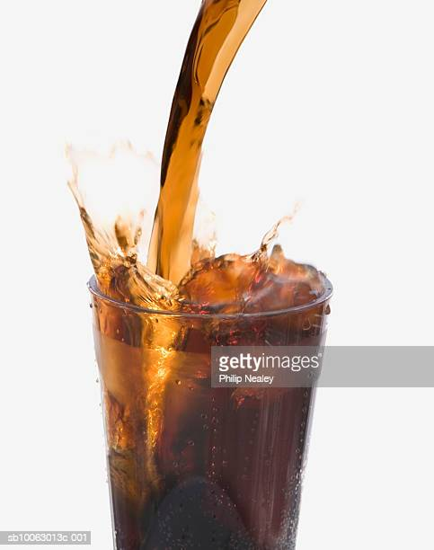 Cola pouring into glass