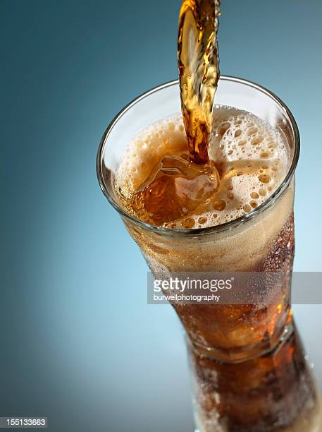 Cola pouring over Ice
