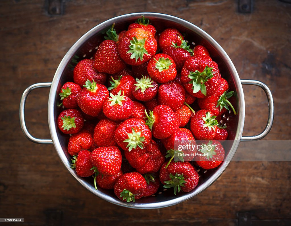 Colander full of ripe strawberries : Stock Photo