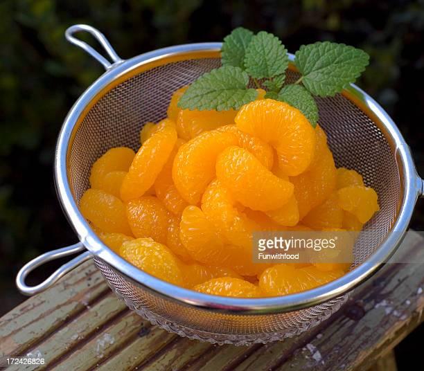 Colander of Draining Canned Mandarin Orange Citrus Fruit