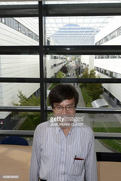 Colaureate of the 2014 Nobel Prize in Physics Japaneseborn researcher Hiroshi Amano poses on October 8 2014 at the Minatec Innovation Campus in...