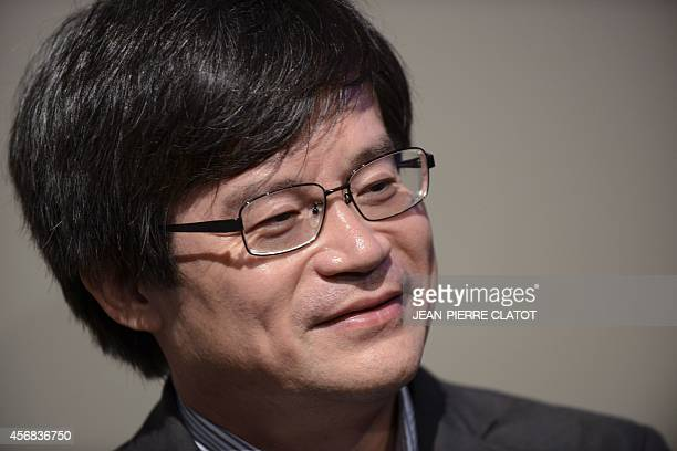 Colaureate of the 2014 Nobel Prize in Physics Japaneseborn researcher Hiroshi Amano holds a press conference on October 8 2014 at the Minatec...