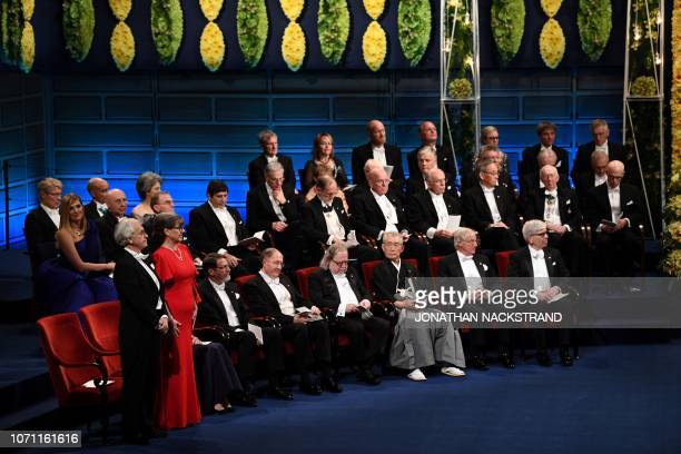 Colaureate of the 2018 Nobel Prize in Physics French physicist Gerard Mourou and Canadian physicist Donna Strickland stand next to other laureates...
