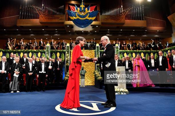 Co-laureate of the 2018 Nobel Prize in Physics French physicist, Canadian physicist Donna Strickland poses with her Nobel Prize during the Award...