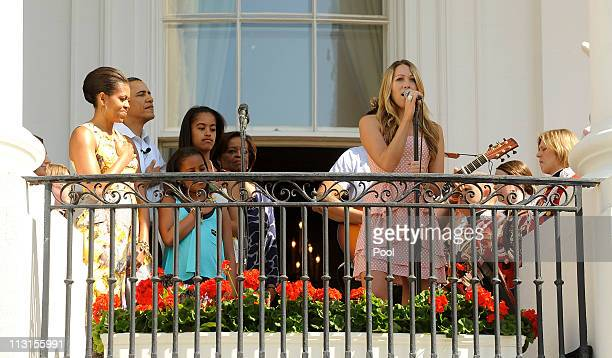 Colbie Caillat sings the National Anthem as first lady Michelle Obama President Barack Obama Sasha Obama Malia Obama and Michelle Obama's mother...