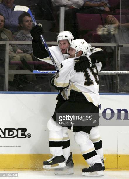 Colby Armstrong and Dominic Moore of the Pittsburgh Penguins celebrate teammate Ryan Whitney's third period goal against the New York Rangers on...