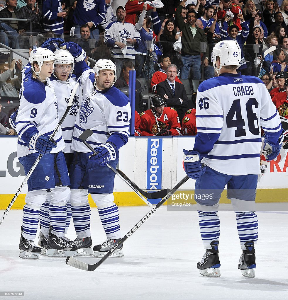 Colby Armstrong #9, Luke Schenn #2, Brett Lebda #23 and Joey Crabb #46 of the Toronto Maple Leafs celebrate a third period goal against the Chicago Blackhawks March 5, 2011 at the Air Canada Centre in Toronto, Ontario, Canada.