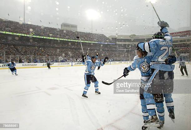 Colby Armstrong of the Pittsburgh Penguins celebrates his goal with teammate Sidney Crosby during the first period of the NHL Winter Classic against...