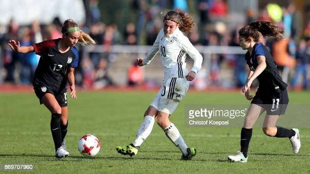 Colby Barnett of United States and Jilian Shimkin of United States challenge Annika Wohner of Germany during the International Friendly match between...