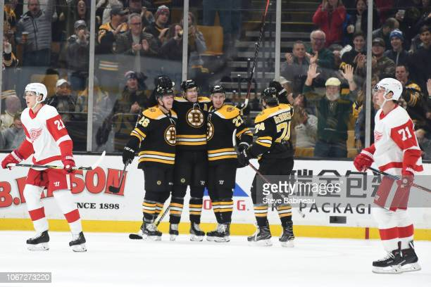 Colby Cave, David Backes, John Moore and Jake DeBrusk of the Boston Bruins celebrate a goal against the Detroit Red Wings at the TD Garden on...