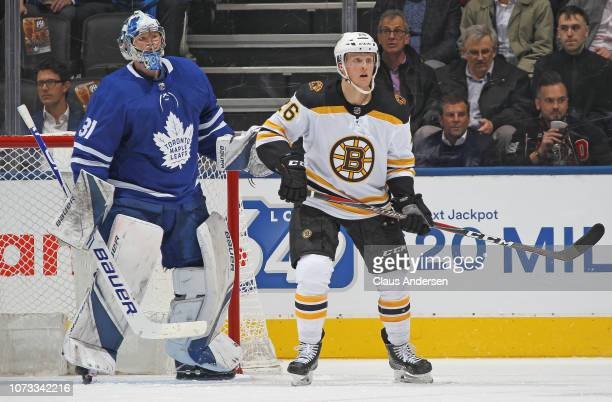 Colby Cave of the Boston Bruins waits for a puck to tip in front of Frederik Andersen of the Toronto Maple Leafs during an NHL game at Scotiabank...