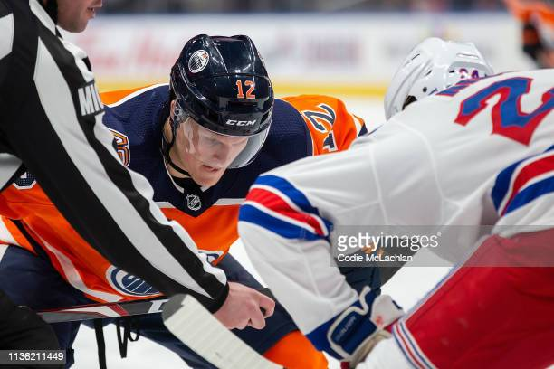 Colby Cave of the Edmonton Oilers faces off against Boo Nieves of the New York Rangers during the second period at Rogers Place on March 11 2019 in...