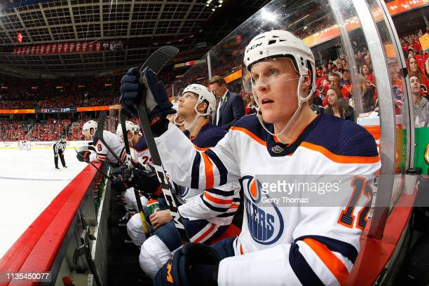 Colby Cave of the Edmonton Oilers sits on the bench during an NHL game against the Calgary Flames on April 6, 2019 at the Scotiabank Saddledome in...