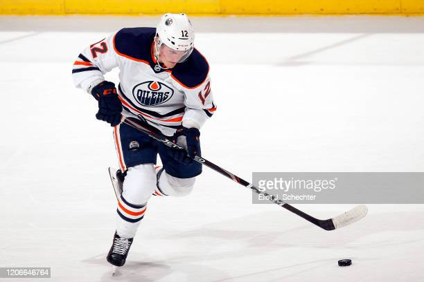 Colby Cave of the Edmonton Oilers skates with the puck against the Florida Panthers at the BBT Center on February 15 2020 in Sunrise Florida