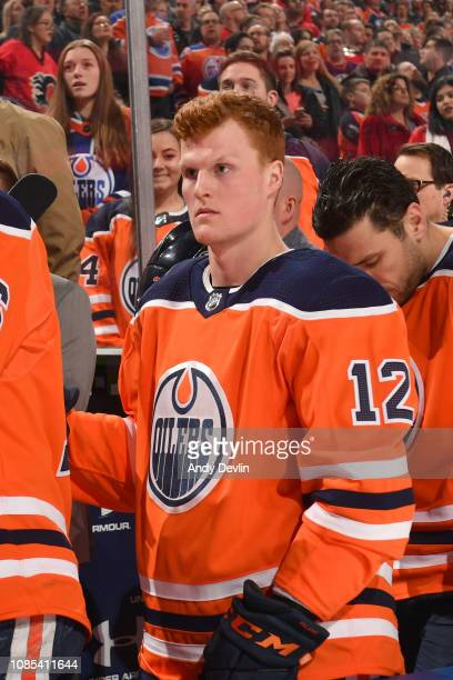 Colby Cave of the Edmonton Oilers stands for the singing of the national anthem prior to the game against the Calgary Flames on January 19, 2019 at...