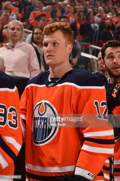 Colby Cave of the Edmonton Oilers stands for the singing of the national anthem prior to the game against the San Jose Sharks on April 4, 2019 at...