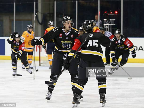 Colby Cohen and Steve Lee of Nottinghm Panthers celebrate the first Panthers goal during the Champions Hockey League group stage game at the National...