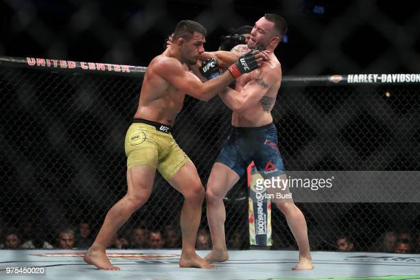 Colby Covington and Rafael Dos Anjos of Brazil grapple in the third round in their welterweight title fight during the UFC 225 Whittaker v Romero 2...