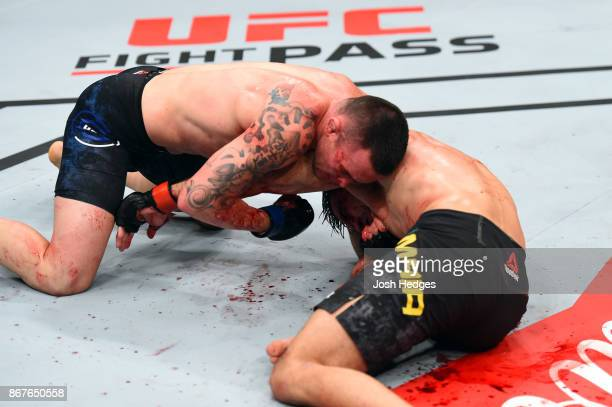 Colby Covington attempts to submit Demian Maia of Brazil in their welterweight bout during the UFC Fight Night event inside the Ibirapuera Gymnasium...