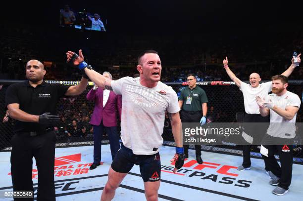 Colby Covington celebrates after defeating Demian Maia of Brazil in their welterweight bout during the UFC Fight Night event inside the Ibirapuera...