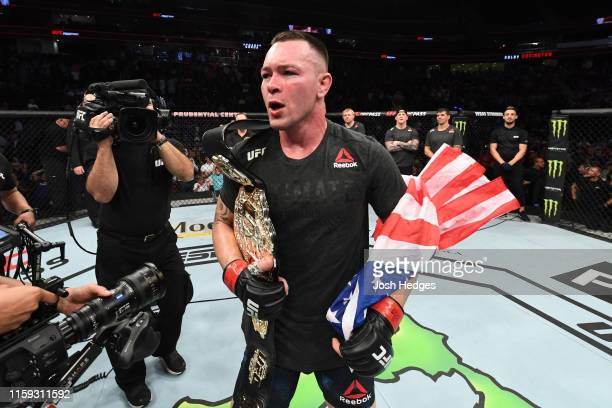 Colby Covington celebrates his victory over Robbie Lawler in their welterweight bout during the UFC Fight Night event at the Prudential Center on...