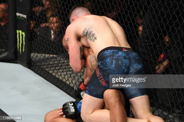 Colby Covington controls the body of Robbie Lawler in their welterweight bout during the UFC Fight Night event at the Prudential Center on August 3,...