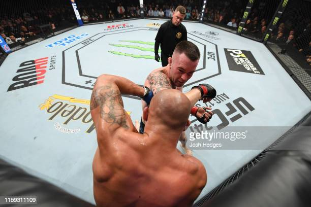 Colby Covington elbows Robbie Lawler in their welterweight bout during the UFC Fight Night event at the Prudential Center on August 3, 2019 in...