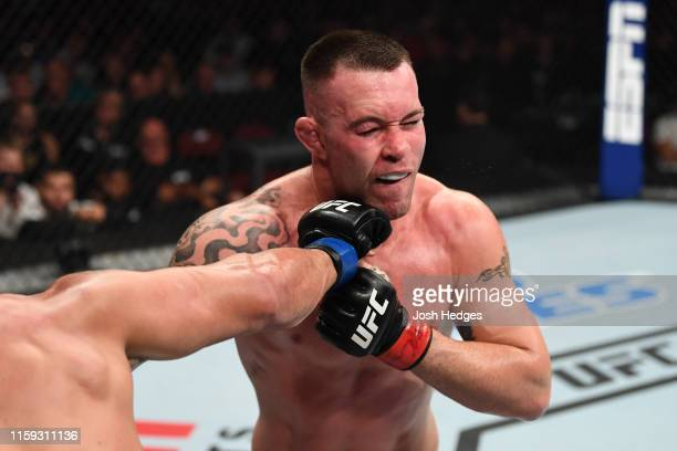 Colby Covington is punched by Robbie Lawler in their welterweight bout during the UFC Fight Night event at the Prudential Center on August 3 2019 in...