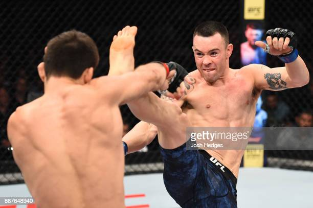 Colby Covington kicks Demian Maia of Brazil in their welterweight bout during the UFC Fight Night event inside the Ibirapuera Gymnasium on October 28...
