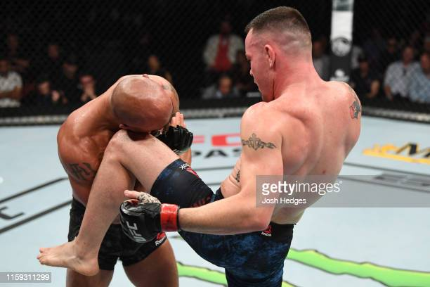 Colby Covington knees Robbie Lawler in their welterweight bout during the UFC Fight Night event at the Prudential Center on August 3 2019 in Newark...