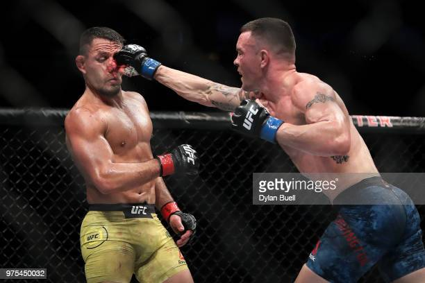 Colby Covington lands a punch against Rafael Dos Anjos of Brazil in the third in during their welterweight title fight during the UFC 225 Whittaker v...