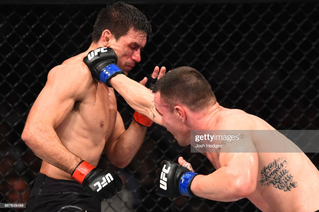 Colby Covington punches Demian Maia of Brazil in their welterweight bout during the UFC Fight Night event inside the Ibirapuera Gymnasium on October 28, 2017 in Sao Paulo, Brazil.
