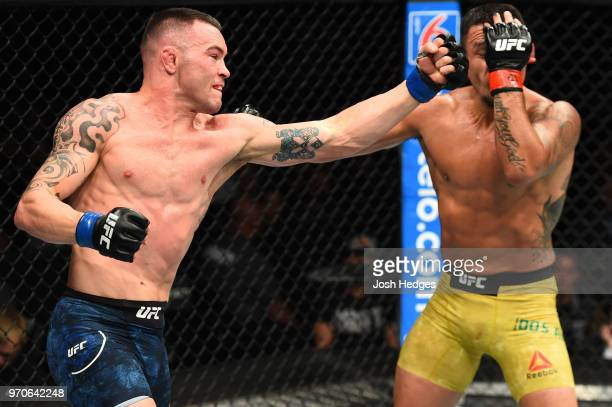 Colby Covington punches Rafael Dos Anjos of Brazil in their interim welterweight title fight during the UFC 225 event at the United Center on June 9...